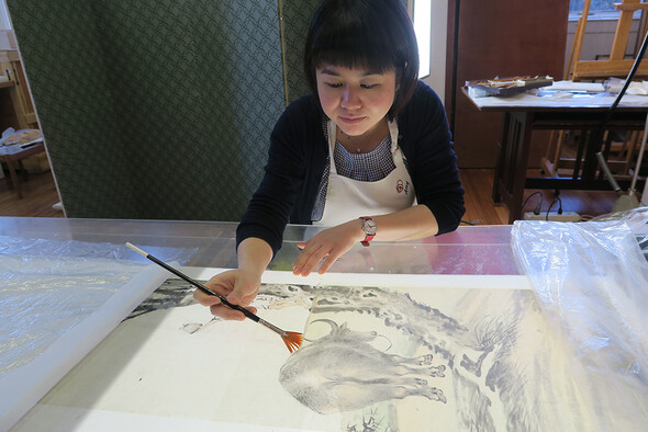 Amy enjoyed learning how to handle the different brushes and papers, and practicing new conservation techniques.