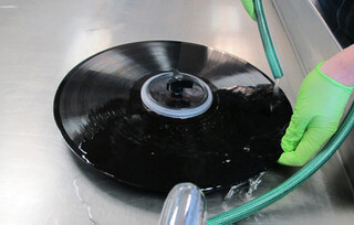 The 'Groovmaster' handle supports the center of the disc during cleaning