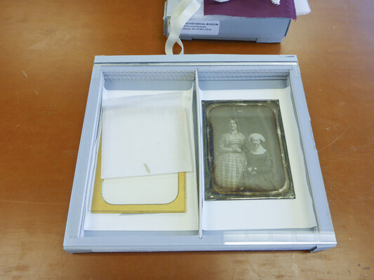 The process began by disassembling the daguerreotype package and placing it in temporary housing as seen here.