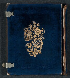 Although velvet-covered book-like cases were common, the gold stamped floral motif is a rare design.