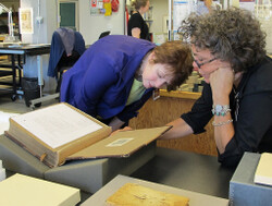 Jude Southward meets with NEDCC Director of Book Conservation MP Bogan to discuss the treatment.