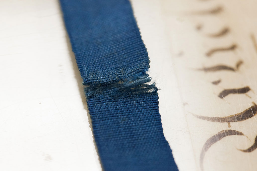 Close-up of fraying ribbon on the 1819 constitution