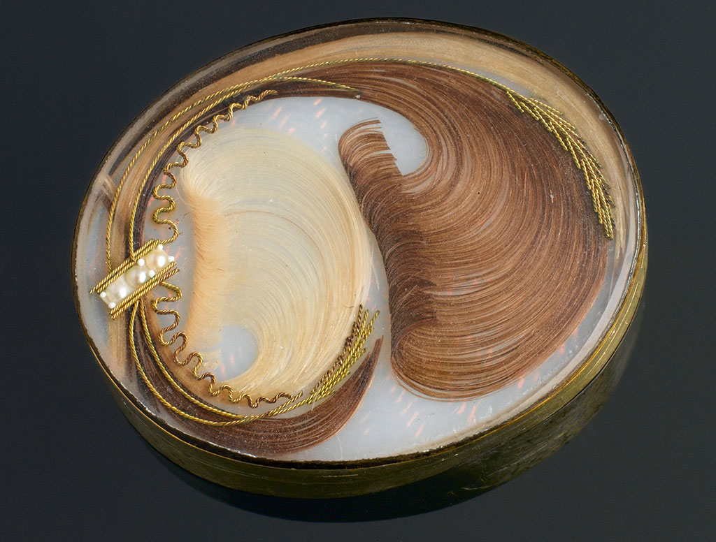 A hair brooch made with two locks of hair. Image credit: Wellcome Trust, photo number L0058632.