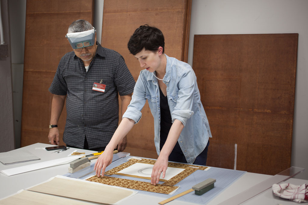 Christina Taylor consults with Mr. Nishio as she determines the size and position of each brocade segment.