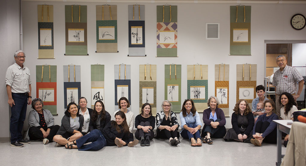 From left to right: Michael Lee, Luana Maekawa, Kimi Taira, Michele Phillips, Erin Jue, Juliet Baines, Angela Campbell, Heidi Nakashima, Alena MacAlasdair, Deborak LaCamera, Amanda Hegarty, Mhairi Boyle, Christina Taylor and Miss Frankie, Brook Prestowitz, Maria Cristina Rivera Ramos, and instructor Yoshi Nishio.